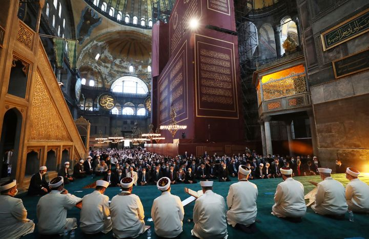 Imams read sermons as Friday as dignitaries, including Turkey's President Recep Tayyip Erdogan, take part in Friday prayers a