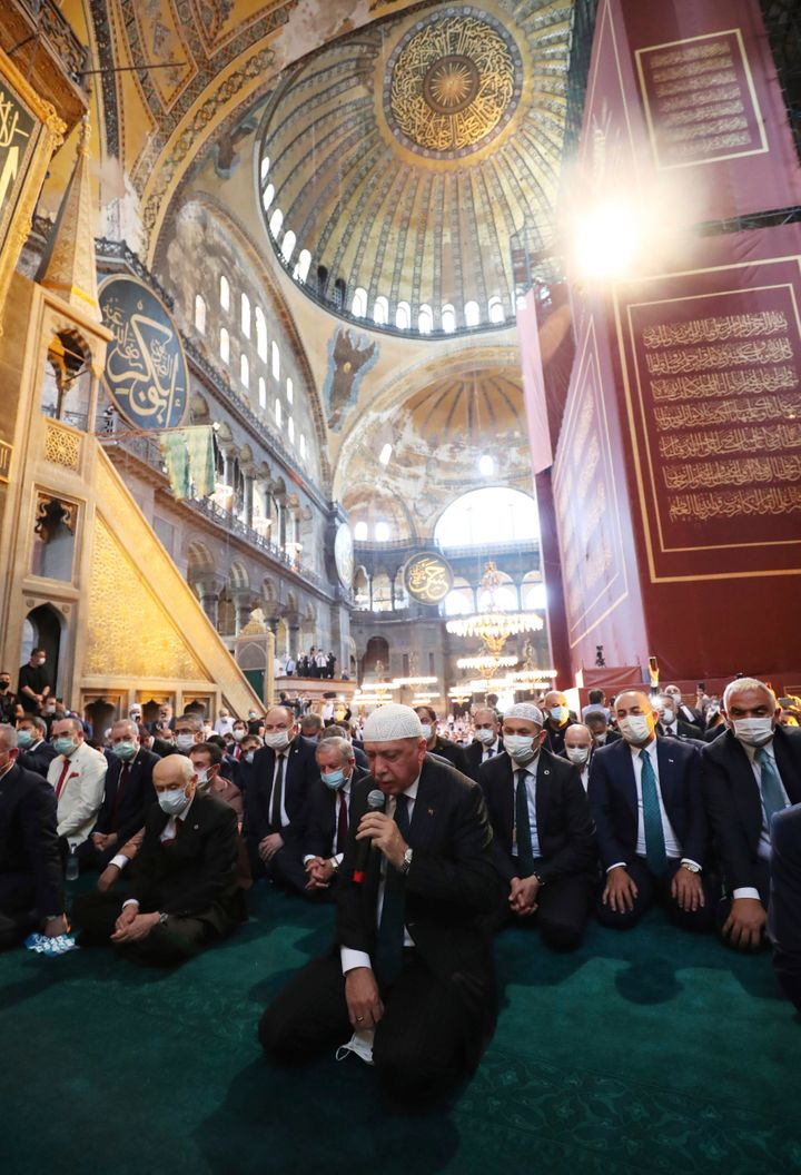 Turkey's President Recep Tayyip Erdogan, center, recites from the Quran during Friday prayers in Hagia Sophia on July 24, 202
