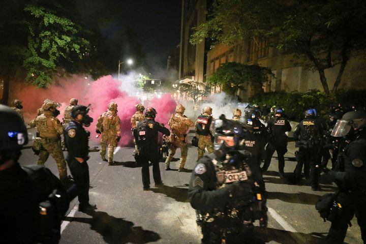 Police respond to protesters during a demonstration July 17 in Portland, Oregon. Militarized federal agents deployed by the p