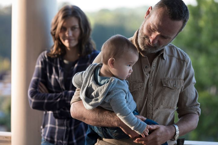 Maggie, Rick and Baby Hershel probably thinking how great it is that Negan isn't there.