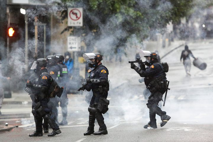 Police use tear gas amid anti-racist protests in Seattle on May 30.