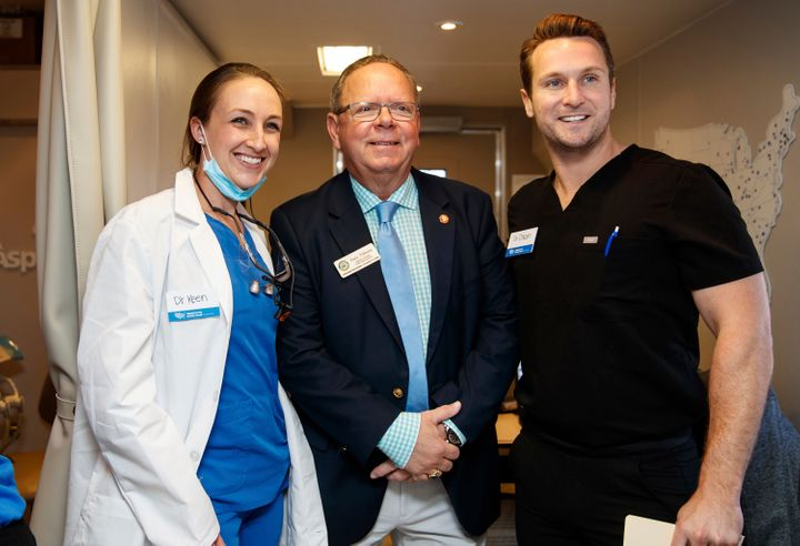 Congressional aide Gary Tibbetts, pictured center in 2019, died from COVID-19 at theManatee Memorial Hospital in Braden