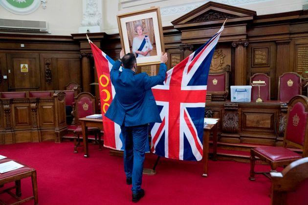 A registrar, Dion Goncalves sets up a citizenship ceremony at Islington Town Hall