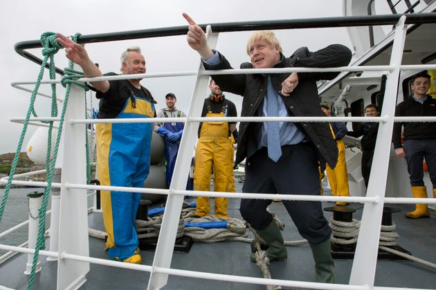 Boris Johnson speaks to members of the crew, on the Carvela at Stromness Harbour in Stromness,...