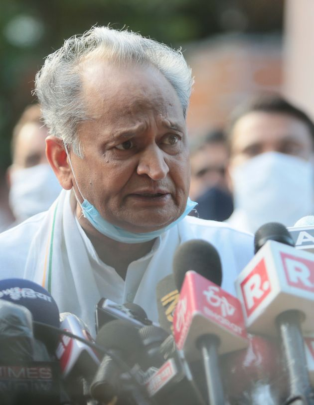 Rajasthan Chief Minister Ashok Gehlot speaks to the media outside the Governors residence on July 24,...