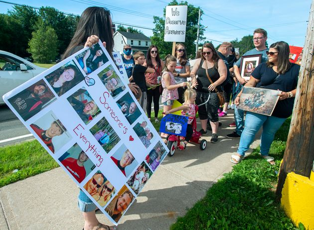 Family and friends of victims attend a march demanding an inquiry into the April mass shooting in Nova...