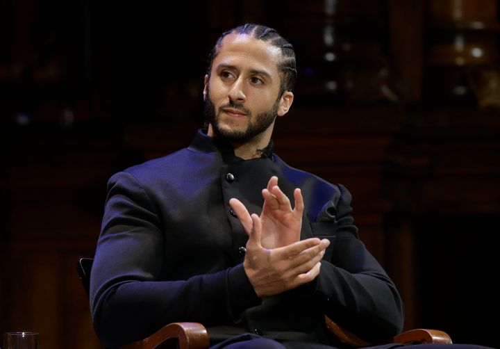 "NFL football quarterback Colin Kaepernick applauds during W.E.B. Du Bois Medal ceremonies at Harvard University in Cambridge, Mass. on Oct. 11, 2018. Kaepernick has been condemned by President Donald Trump and others on the right and has not played an NFL game since 2016, when he began kneeling during the National Anthem to protest ""a country that oppresses black people and people of color."" But he has appeared in Nike advertisements, been honoured by the ACLU and Amnesty International among other organizations and reached an agreement with the Walt Disney Co. for a docuseries about his life."