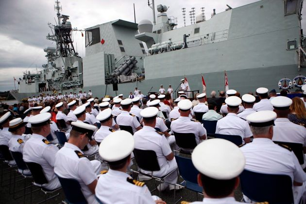 Rear-Admiral Bill Truelove presides over the changing of command from Commodore Bob Auchterlonie to Captain...