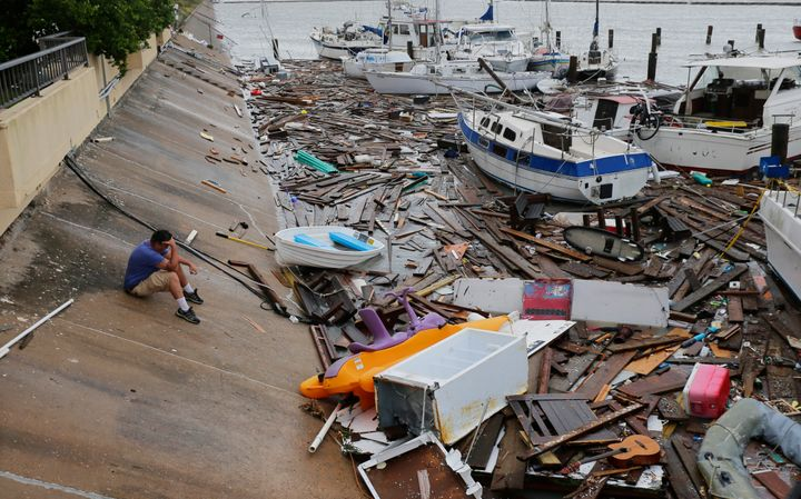 Allen Heath surveys the damage to a private marina after it was hit by Hurricane Hanna on Sunday in Corpus Christi, Texas.&nb