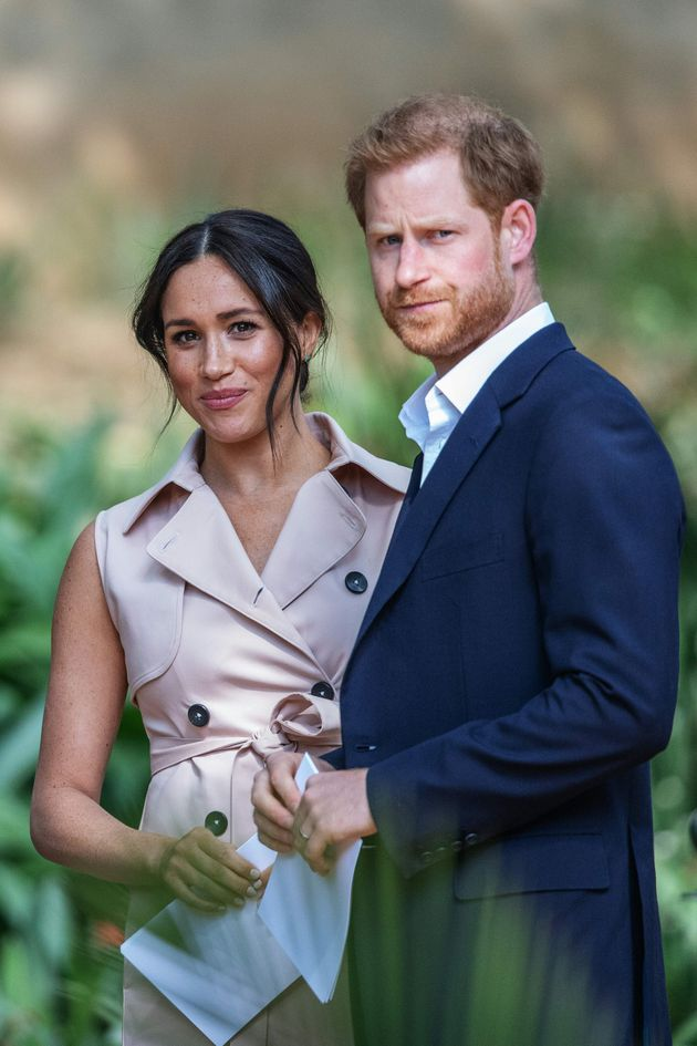 Britain's Prince Harry, Duke of Sussex(R) and Meghan, the Duchess of Sussex(L) arrive at the British...