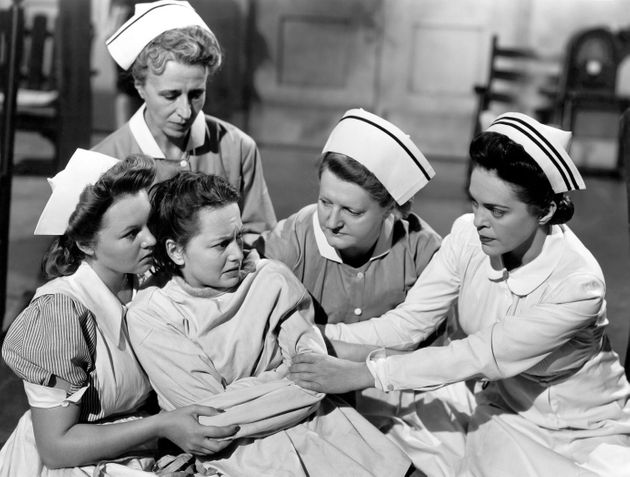 Actress Olivia de Havilland with Ruth Clifford and Helen Craig in a scene from the movie