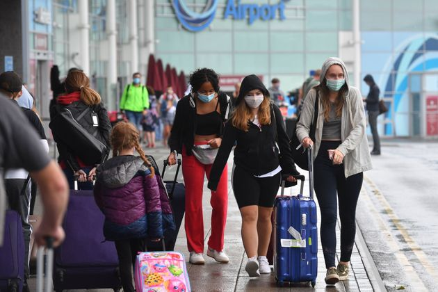 Passengers arriving at Birmingham Airport, as people arriving into England from holidays in Spain have...