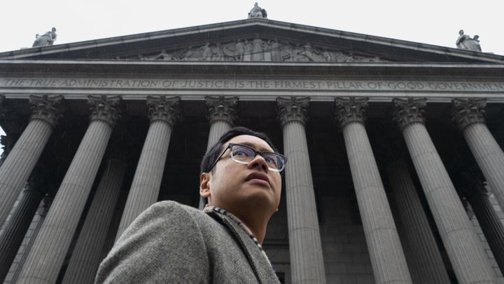 Ho stands on the Supreme Court steps on the day he argued the case against the Trump administration's effort to add a citizen