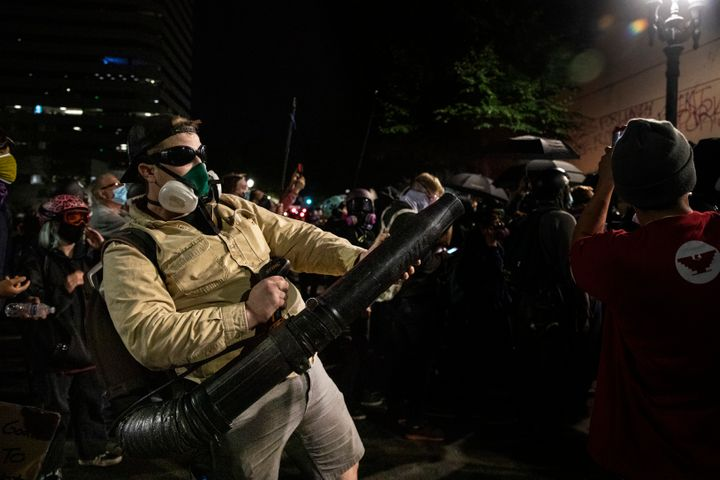 A protester uses a leaf blower to direct tear gas back towards the federal police n front of the Mark O. Hatfield U.S. Courthouse during protests on July 25, 2020 in Portland, Oregon.