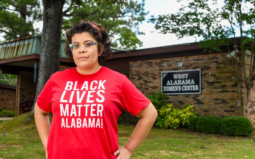 Activist Amanda Reyes stands outside West Alabama Women's Center on June 5. Reyes started the Yellowhammer Fund, which raised