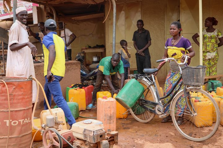 Burkina Faso is one of Africa's nations hardest hit by the coronavirus with one of the highest number of fatalities in sub-Saharan Africa. In this photo from March 24 , 2020, residents wait in line to fill their jerry cans, as people often have to walk half an hour to the closest water point several times a day and wait in crowded lines in order to get enough water to wash hands, bathe and cook.