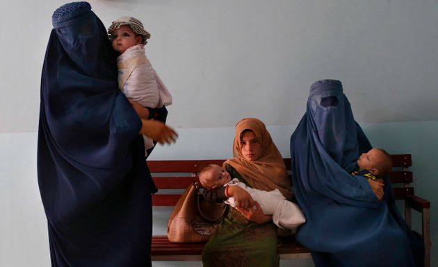 Mothers along with babies who suffer from malnutrition wait at a UNICEF clinic in Jabal Saraj, north...