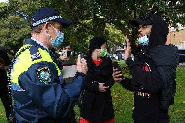 Police speak to rally organiser and nephew of David Dungay Jnr Paul Silva during a Black Lives Matter...