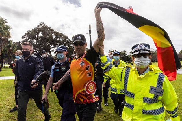 A man is detained by Police in the Domain on July 28, 2020 in Sydney,
