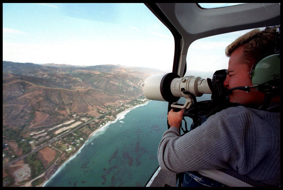 A Photographer takes an aerial view of Brad Pitt and Jennifer Aniston's wedding venue July 29, 2000 in...
