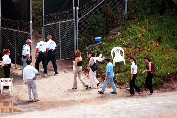 Guests are escorted by security into the wedding of Brad Pitt and Jennifer Aniston in Malibu, CA