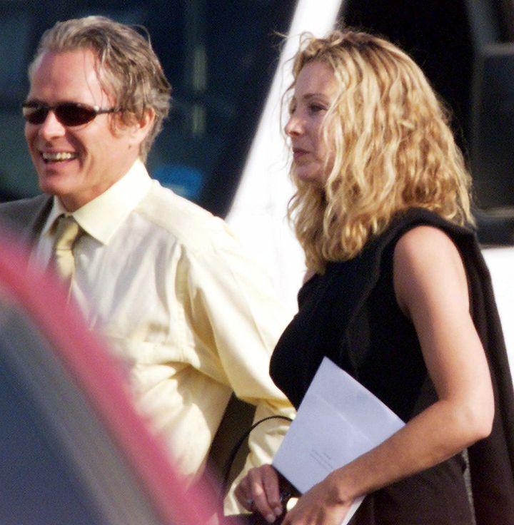 Lisa Kudrow and her husband arrive in Malibu, Calif., for the wedding of Jennifer Aniston and Brad Pitt