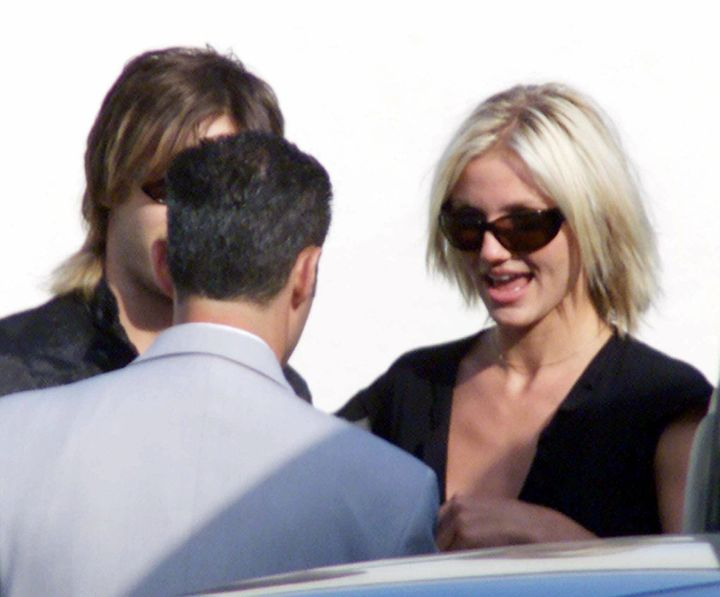 Cameron Diaz talks with unidentified guests at the wedding of Brad Pitt and Jennifer Aniston