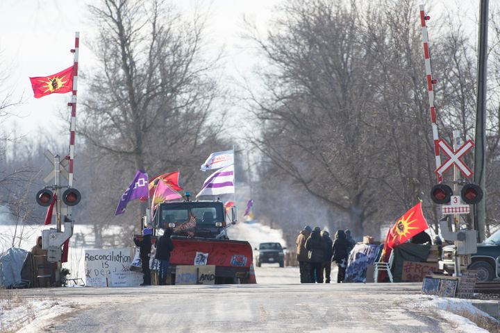 First Nations people protest at a train blockade in Tyendinaga, near Belleville, Ontario, Canada on Feb. 21. The blockades we