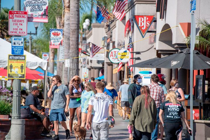 "Beachgoers, many maskless, walk down Main Street in Huntington Beach, California. Residents of the city south of Los Angeles have been notably&nbsp;<a href=""https://www.latimes.com/socal/daily-pilot/news/story/2020-06-30/huntington-beach-restaurants-no-mask-position-deeply-divides-o-c-diners"" target=""_blank"" rel=""noopener noreferrer"" data-ylk=""subsec:paragraph;itc:0;cpos:1;pos:3;elm:context_link"" data-rapid_p=""3"" data-v9y=""1"">anti-mask</a>&nbsp;and <a href=""https://timesofsandiego.com/politics/2020/05/01/thousands-many-without-masks-protest-lockdown-in-huntington-beach/"" target=""_blank"" rel=""noopener noreferrer"" data-ylk=""subsec:paragraph;itc:0;cpos:1;pos:4;elm:context_link"" data-rapid_p=""4"" data-v9y=""1"">lockdown-averse,</a>&nbsp;in spite of rising coronavirus cases in the region."