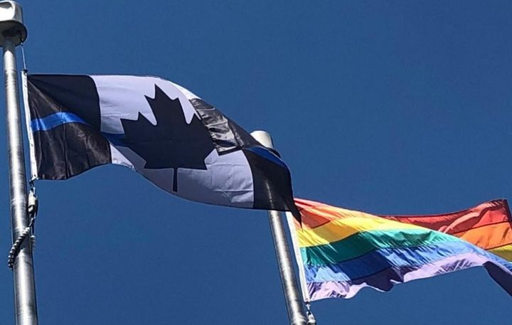 """The Ontario Provincial Police Association replaced its red and white Canadian flag with a """"thin blue line"""" version, similar to the one pictured here, outside of its Barrie, Ont. headquarters in June 2020."""