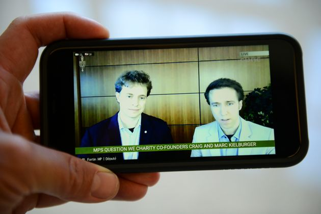 Marc Kielburger and Craig Kielburger are pictured on CPAC as they appear as witnesses via videoconference...