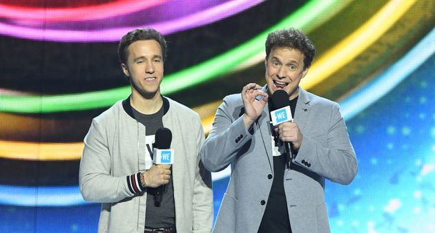 WE Craig Kielburger and Mark Kielburger speak on stage during WE Day California on April 25,