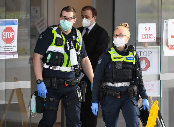 Police leave the Epping Gardens aged care facility in the Melbourne suburb of Epping on July 29, 2020, as the city battles fresh outbreaks of the COVID-19 coronavirus.