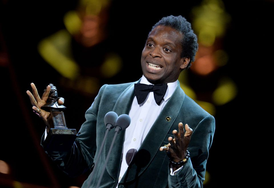 Kobna Holdbrook-Smith on stage at The Olivier Awards 2019 after winning the Best Actor in a...