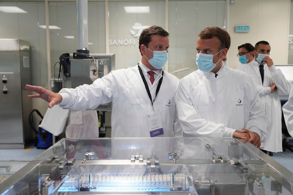 French president Emmanuel Macron visits an industrial development laboratory at French drugmaker's vaccine...