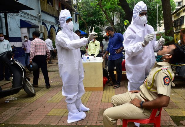 BMC medical staff conducts the antigen test of a Mumbai Police personnel posted at Mahim Police Station...