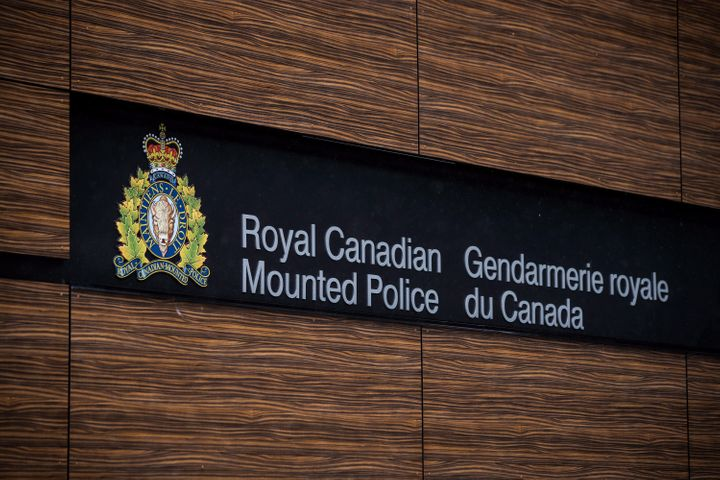 """The RCMP logo is seen outside Royal Canadian Mounted Police """"E"""" Division Headquarters in Surrey, B.C. on April 13, 2018."""