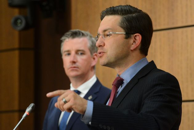 Conservative MP's Pierre Poilievre and Michael Barrett hold a press conference on Parliament Hill in...