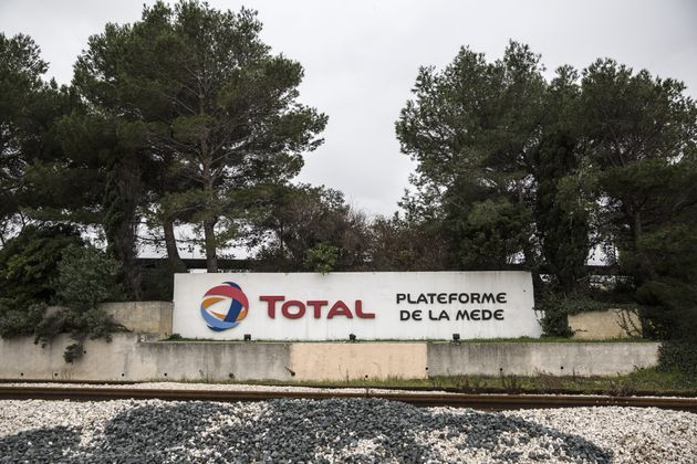 Signage for French energy company Total is seen here in La Mede, France, in December