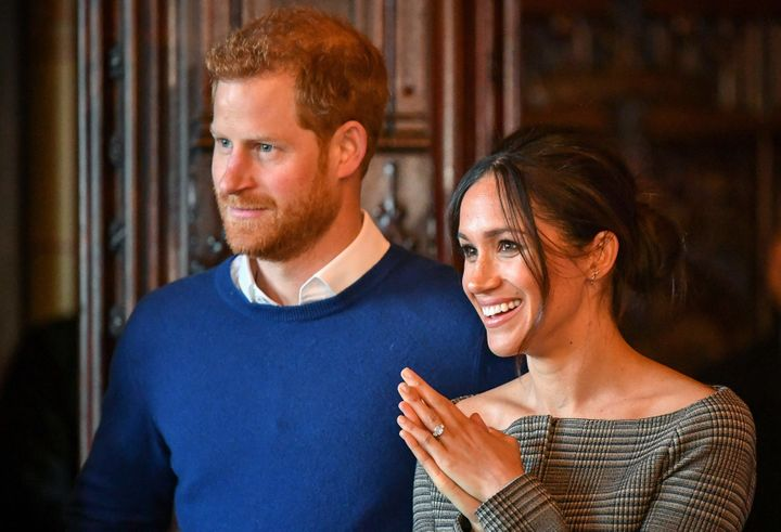 Harry and Meghan watch a performance by a Welsh choir in the banqueting hall during a visit to Cardiff Castle on Jan. 18, 201