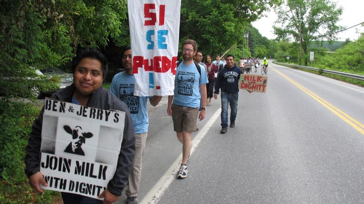 "Dairy farm workers and activists march in 2017 to the main Ben & Jerry's production facility in Vermont to call for ""Milk With Dignity,"" a campaign to obtain fair wages and living conditions for migrant workers."