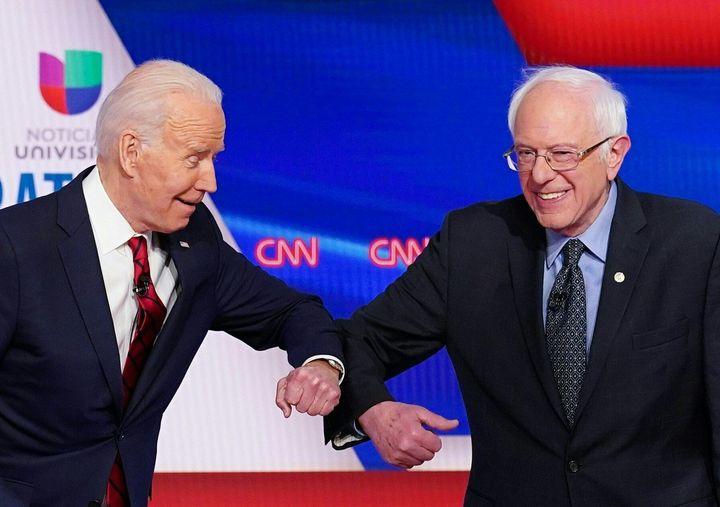 Allies of former Vice President Joe Biden (left) and Sen. Bernie Sanders (I-Vt.) both voted to extend presidential primary re