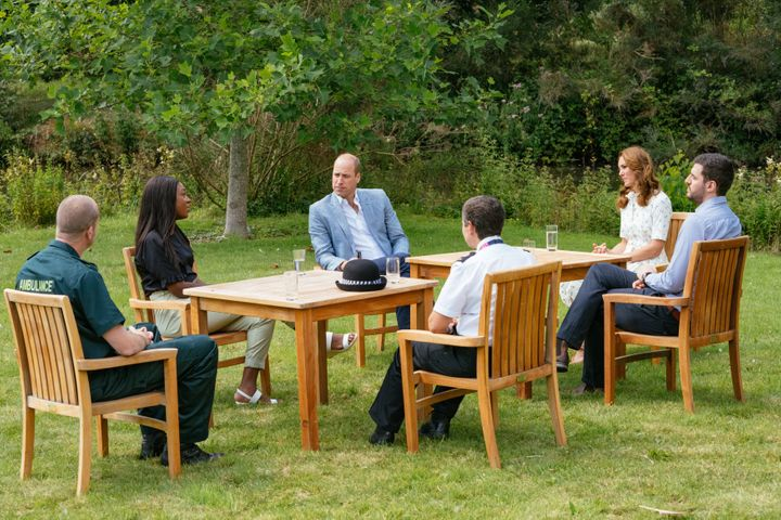 Prince William and Kate Middleton speak to representatives from groups who will receive money from the Royal Foundation's CAD $3 million fund to support frontline workers and U.K. mental health.