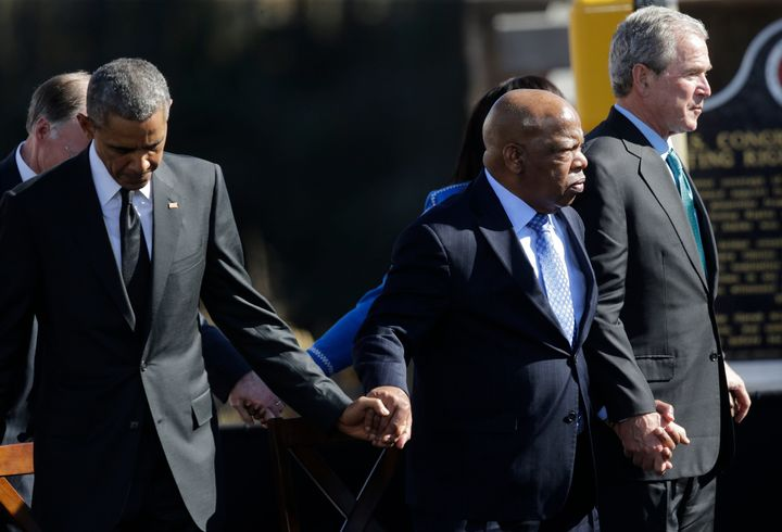 President Barack Obama, Rep. John Lewis, and former President George W. Bush hold hands on March 7, 2015, during a cerem