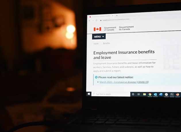 The employment insurance section of the Government of Canada website is shown on a laptop in Toronto...