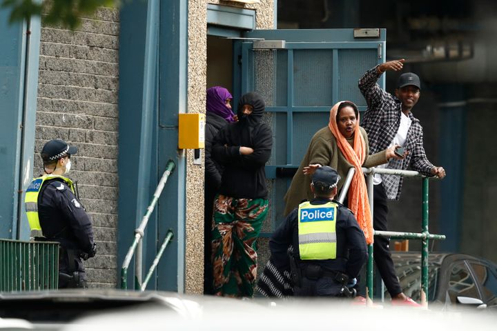 Residents talk with police officers at the Flemington Towers Government Housing complex on July 6 in Melbourne, Australia.