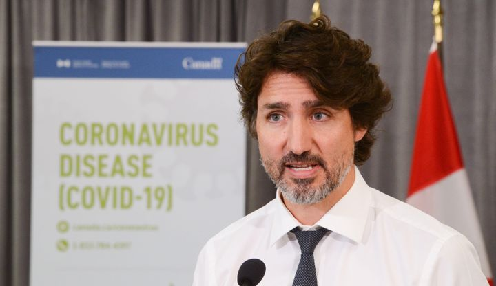 Prime Minister Justin Trudeau holds a press conference as he visits the Public Health Agency of Canada during the COVID-19 pandemic in Ottawa on July 31, 2020.
