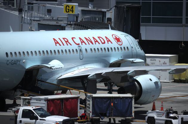 An Air Canada plane sits parked at the gate at San Francisco International Airport on June 30, 2020 in...