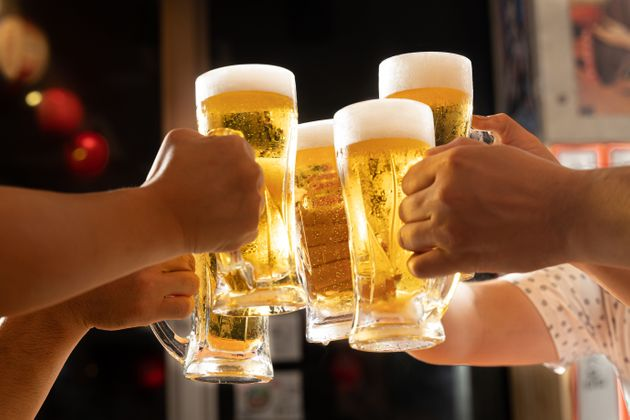 Image of toasting with beer at a