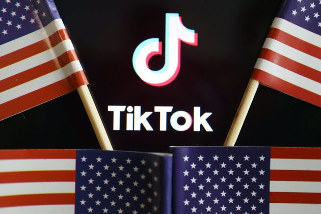U.S. flags are seen near a TikTok logo in this illustration picture taken July 16, 2020. REUTERS/Florence